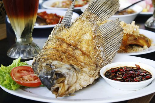 Served fried carp of vegetable