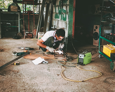Welder working in a garage